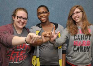 Students in American Sign language studies signing SWIC