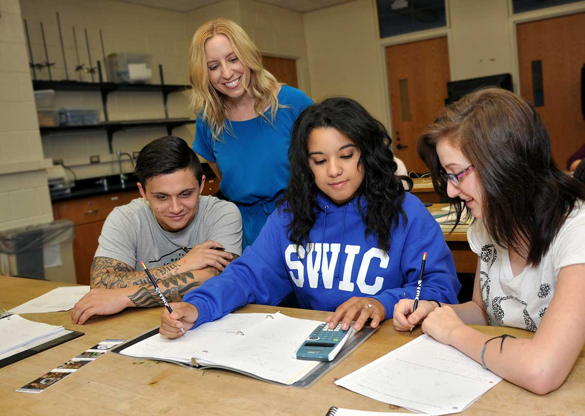Southwestern Illinois College A group of students completing a math assignment