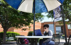 SWIC Student studying outside