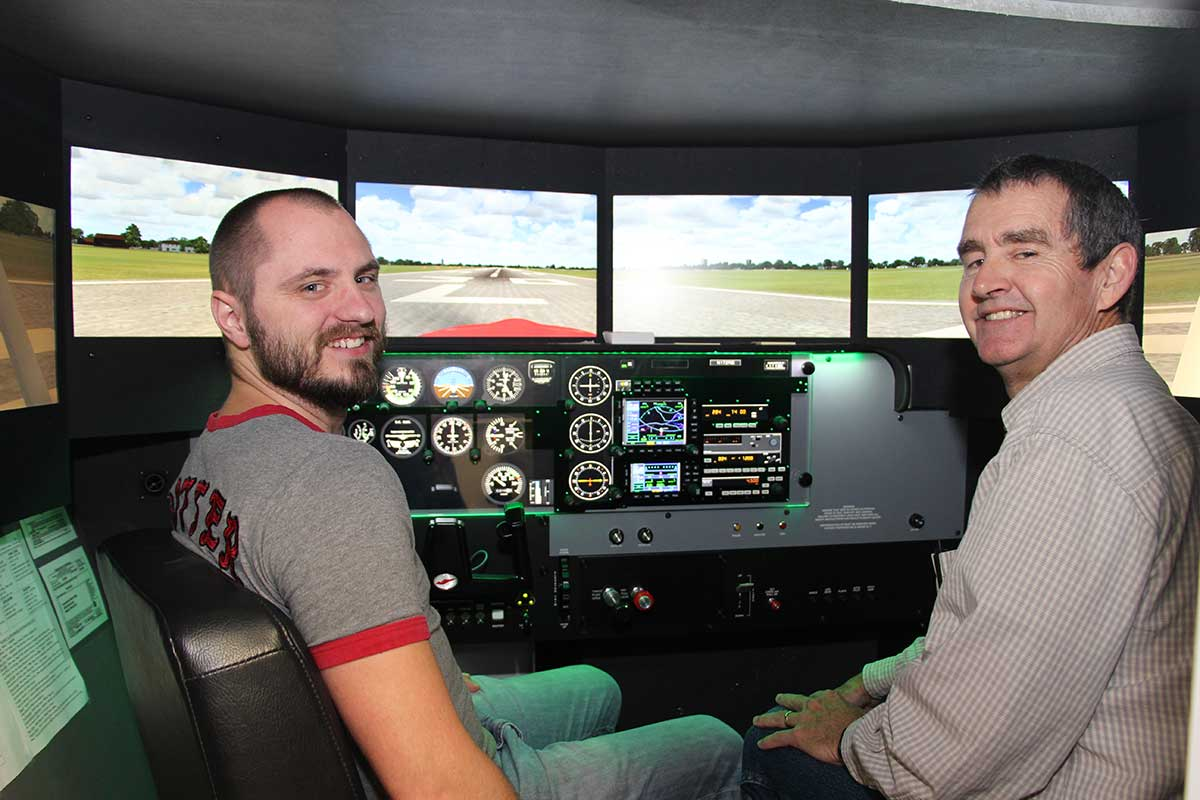 student and instructor in simulator