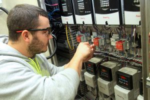 student working on industrial electronics