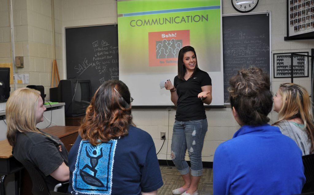 women doing a presentation about communication.