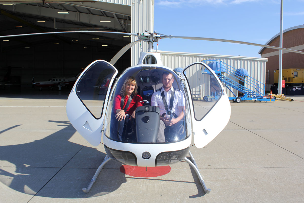 student and flight instructor in helicopter