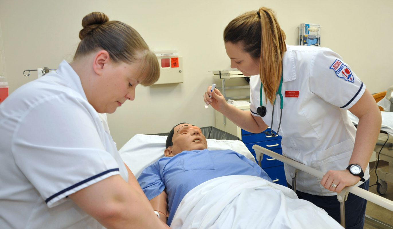 Nursing Education Students working with simulation model