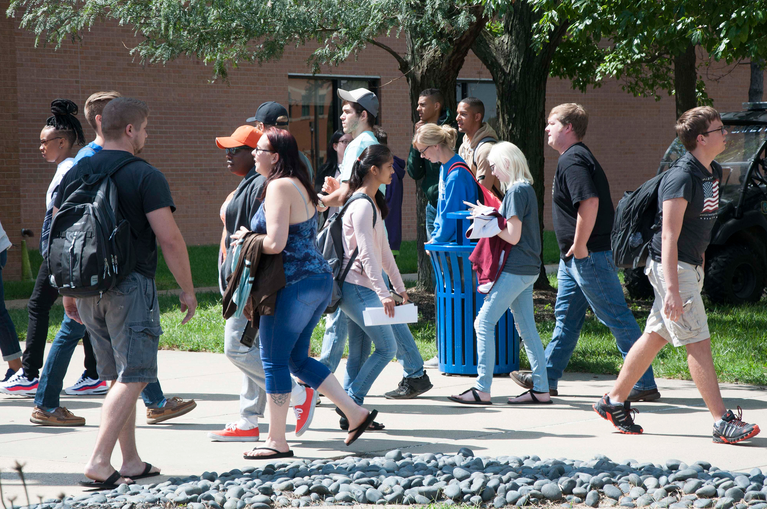 A group of students walking through the Belleville campus.