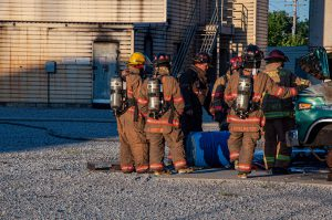 A group of firefighters preparing for a fire training exercise.