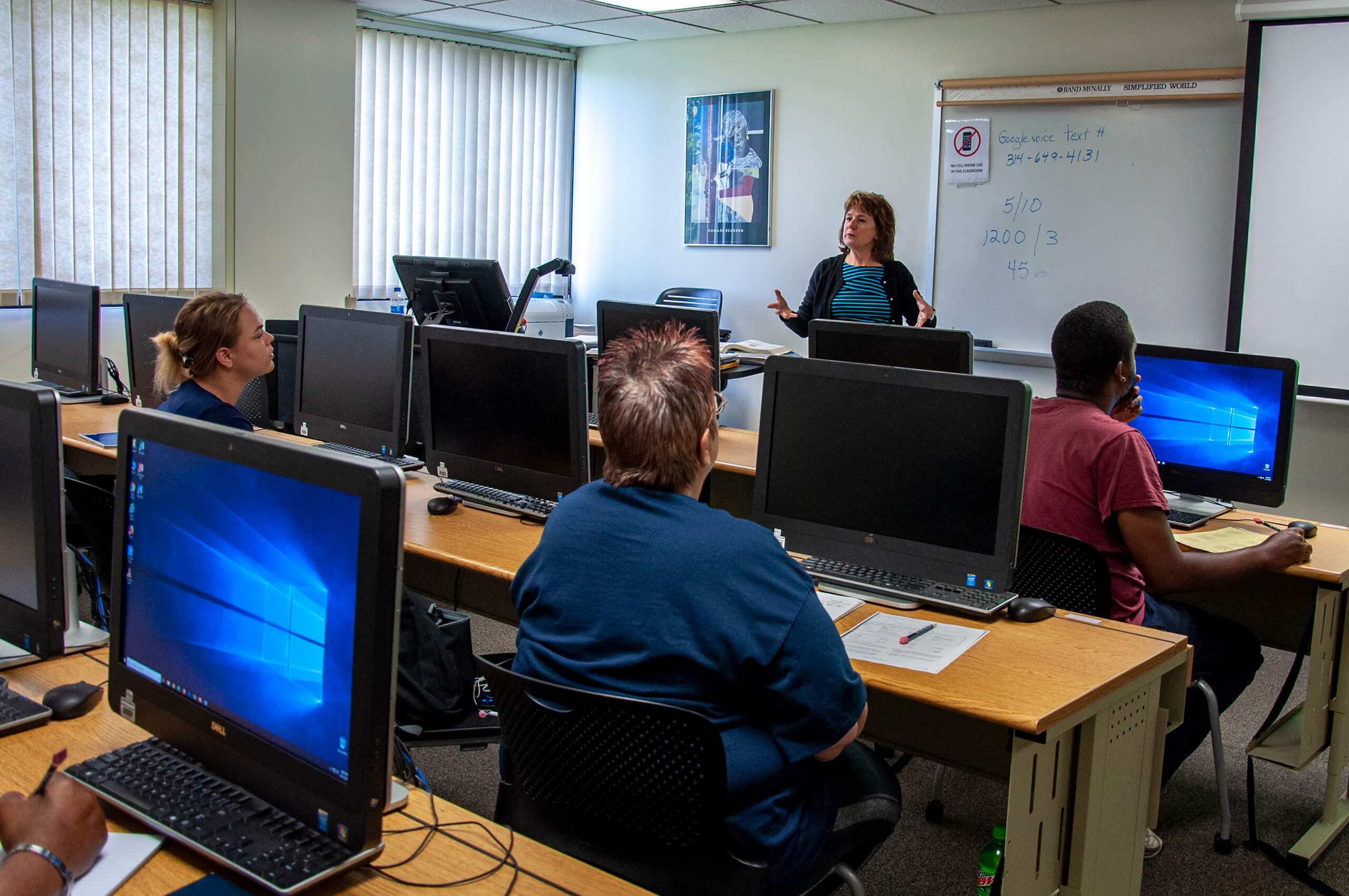 Students listening to an instructor in the adult education program.