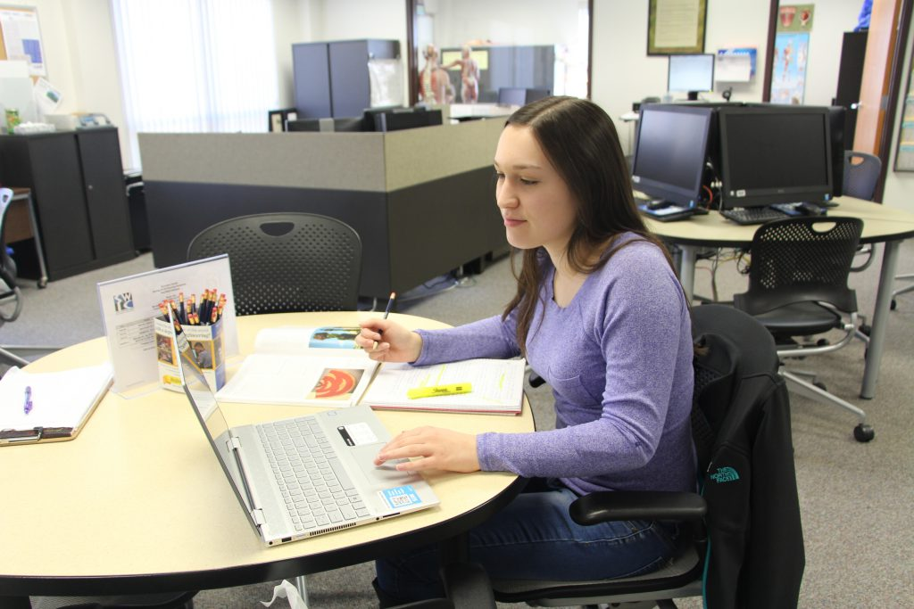 Red Bud Campus student working in the success center