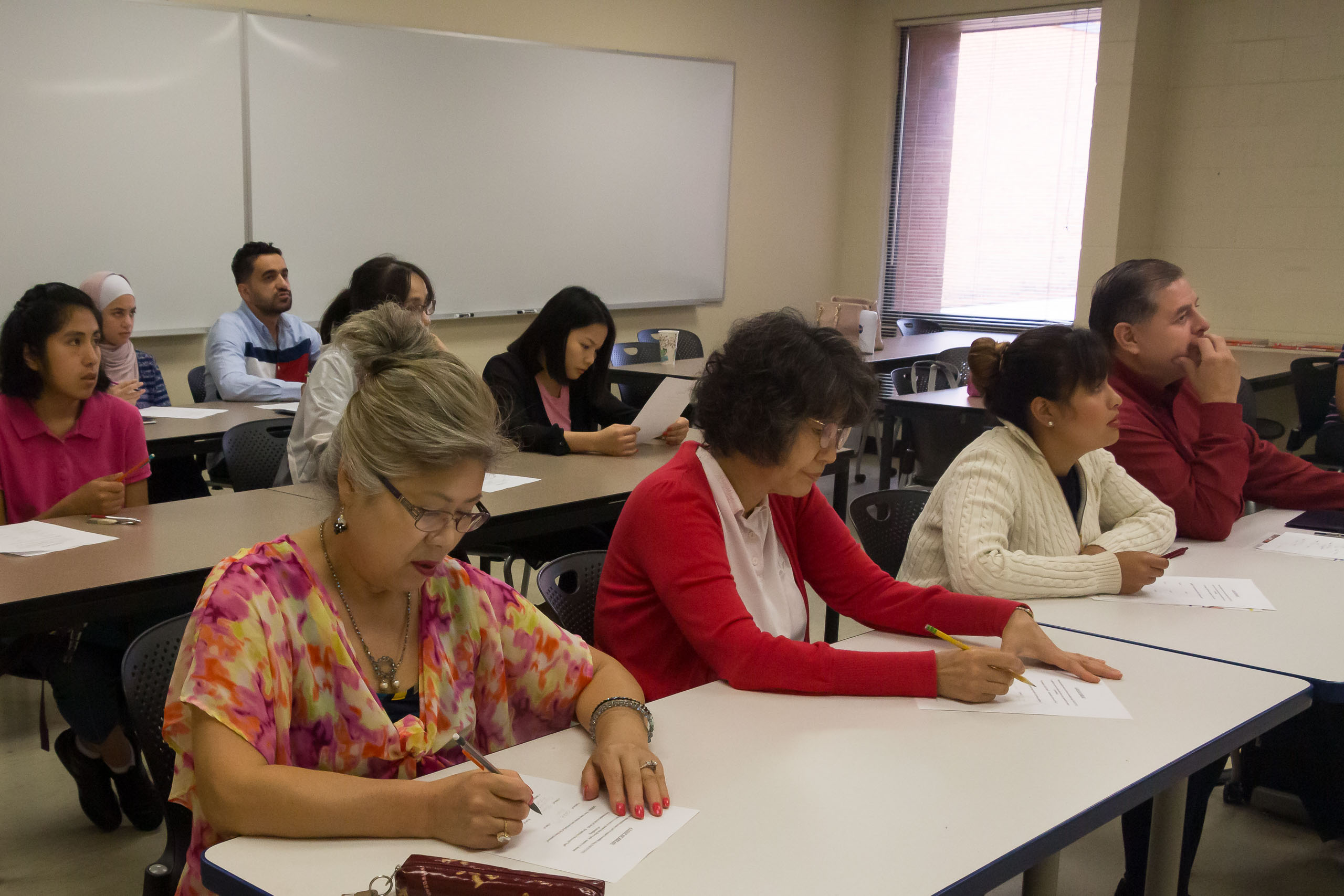 Photo of students working on an assignment in an English as a second language course.