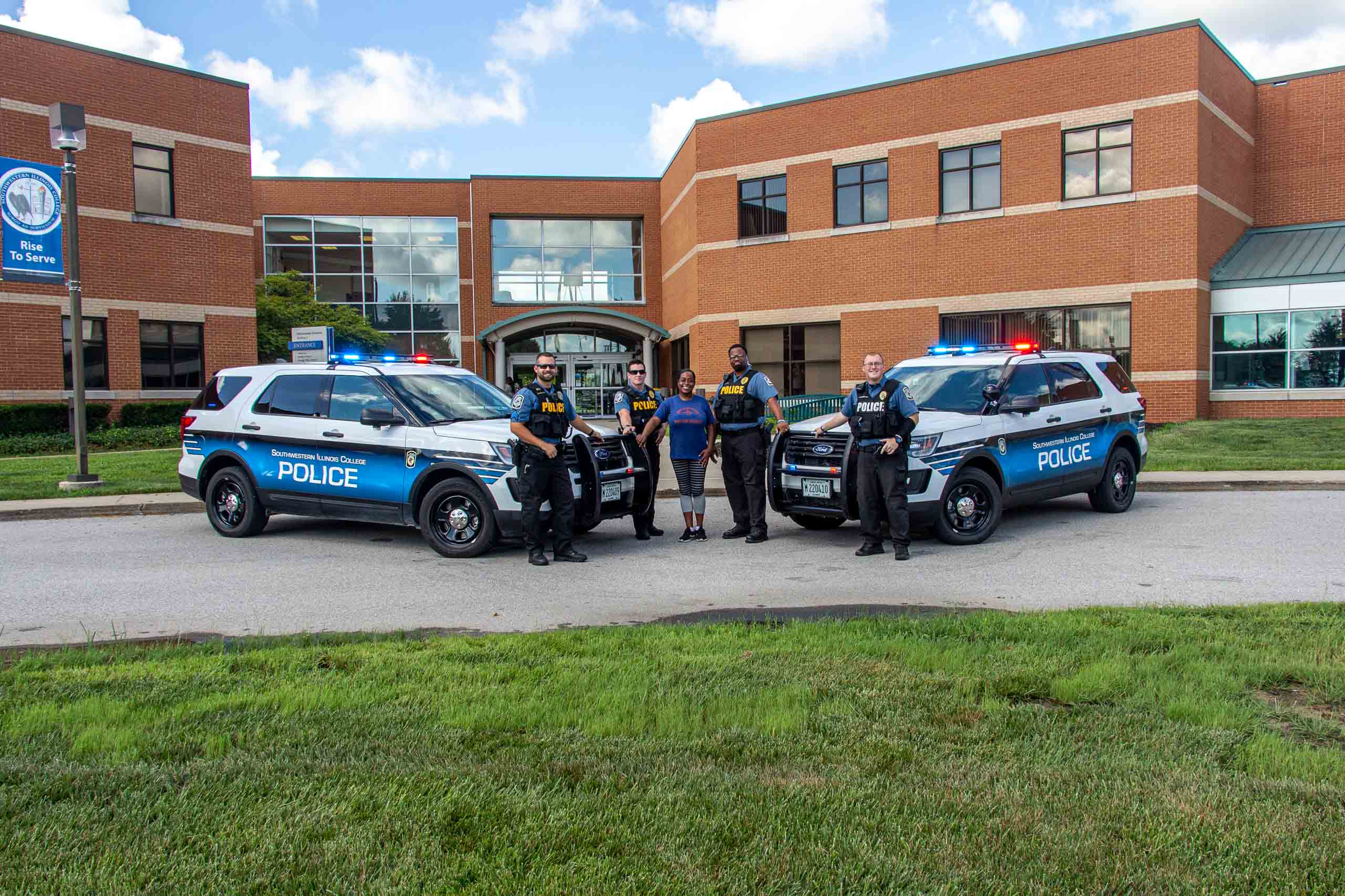 Public Safety Officers posing with student.