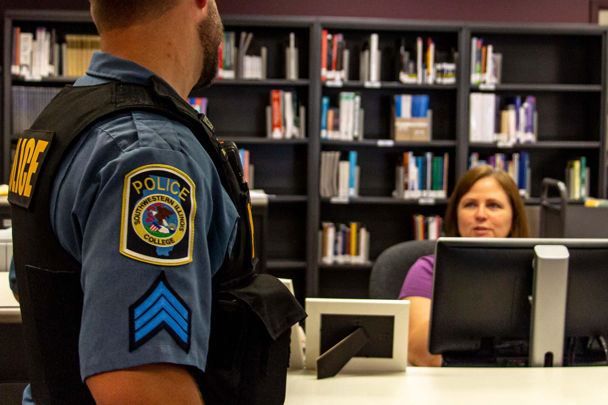 Officer speaking to staff.
