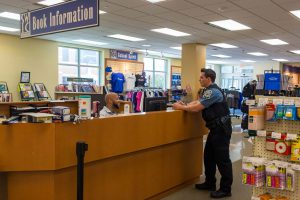 Officer speaking to Book Information attendant at SWIC Book Store.