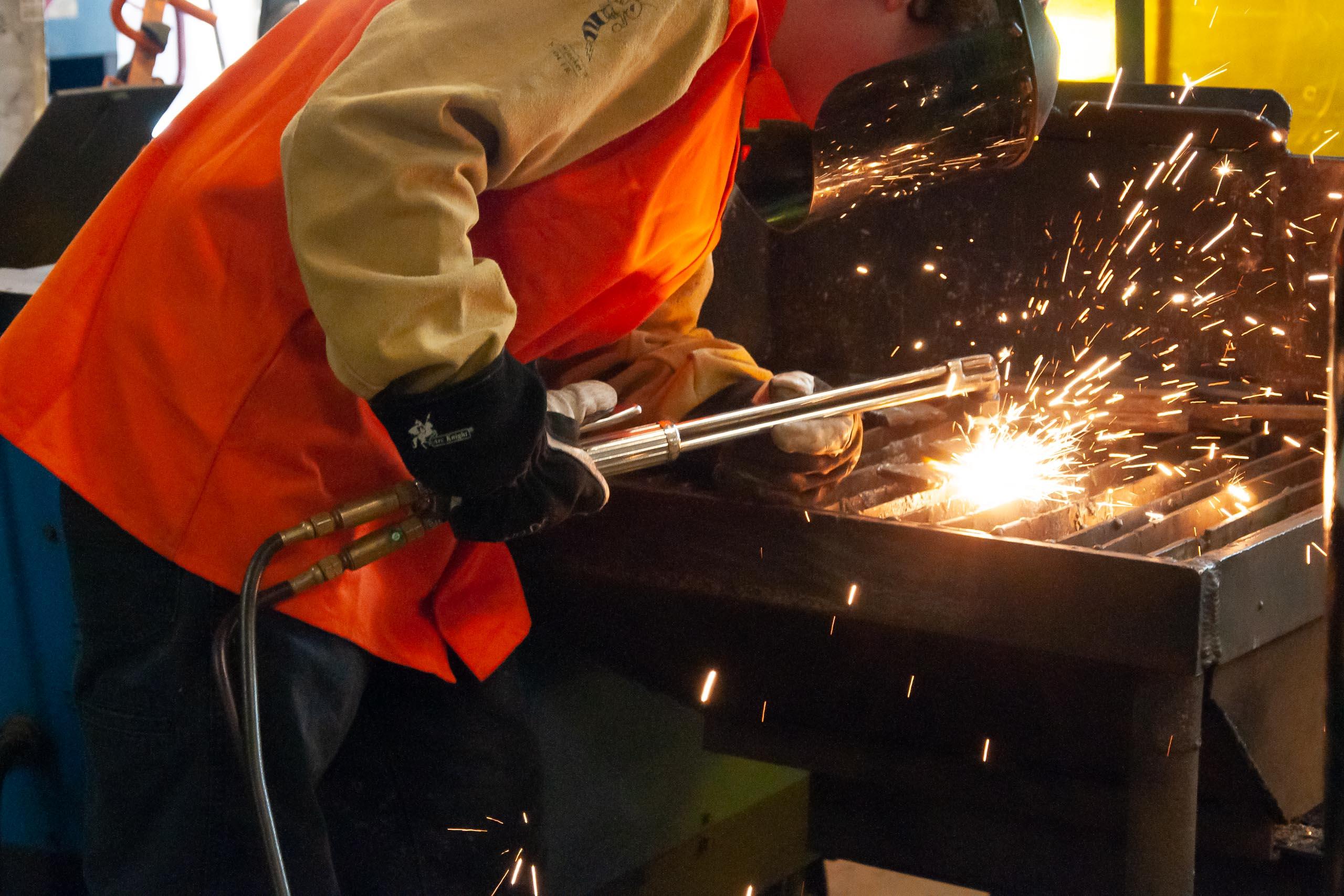 Student welding in welding class.