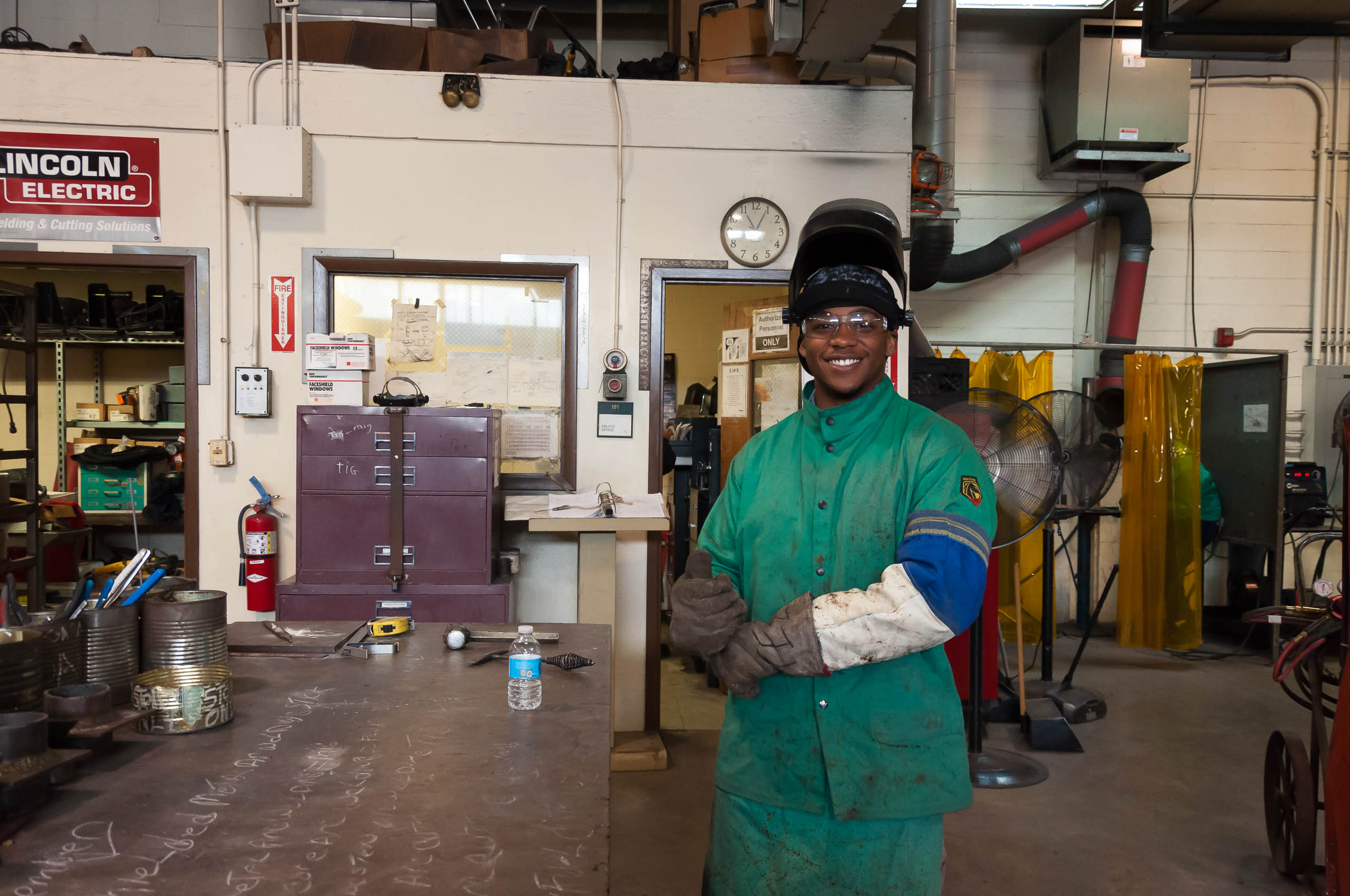 Student smiling in welding class.