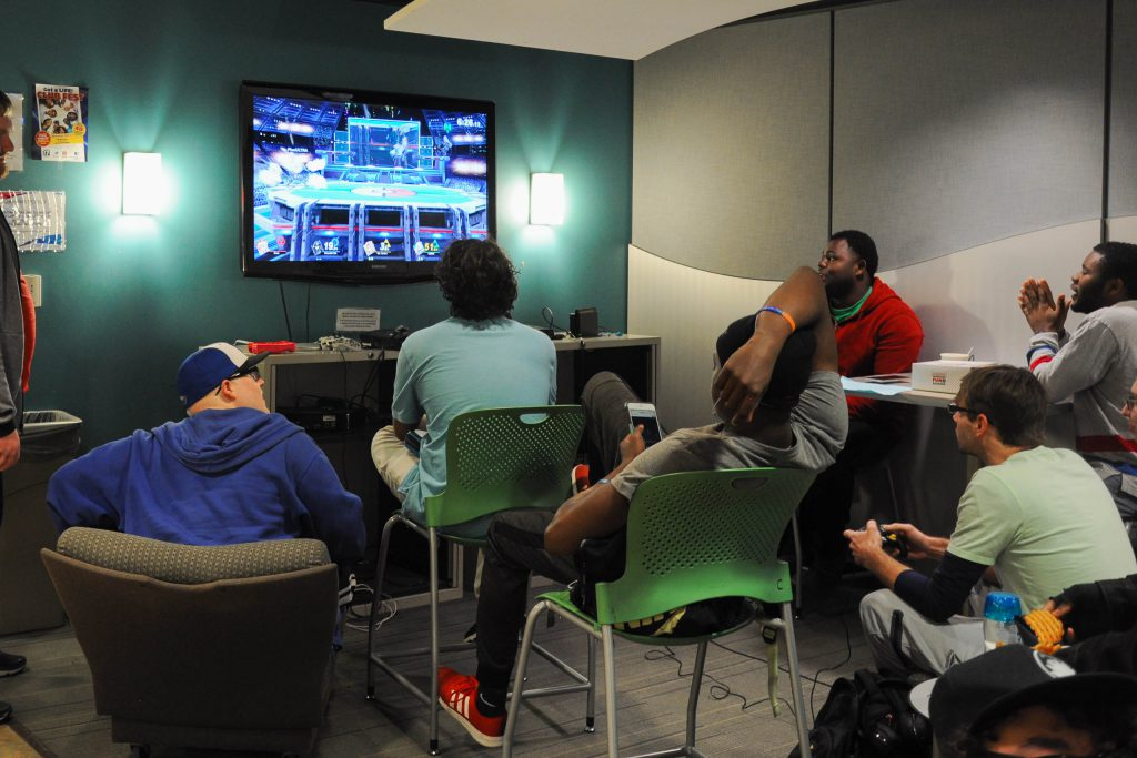 Students playing Super Smash Bros and enjoying their time in the Cyber Lounge.