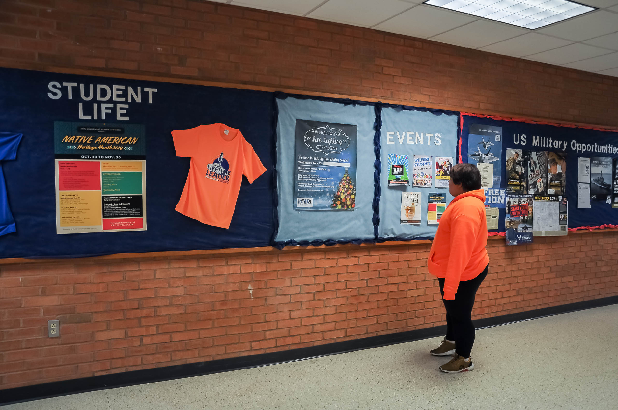 A student looking at SWIC events in the hallway.