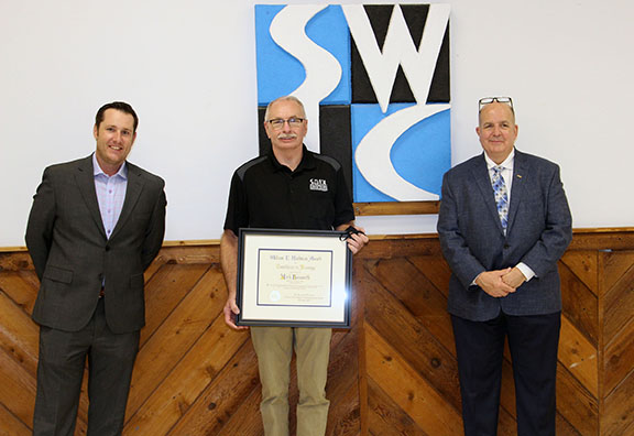 NTMA officials present Mark Bosworth with an award